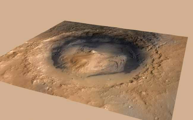 Curiosity Cradled by Gale Crater, NASA's Curiosity rover landed in the Martian crater known as Gale Crater, which is approximately the size of Connecticut and Rhode Island combined. A green d...