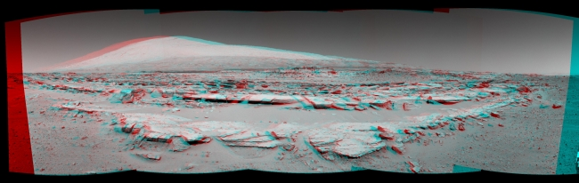 Martian Landscape With Rock Rows and Mount Sharp (Stereo), This stereo landscape scene from NASA's Curiosity Mars rover shows rows of rocks in the foreground and Mount Sharp on the horizon. It appears three dimension...