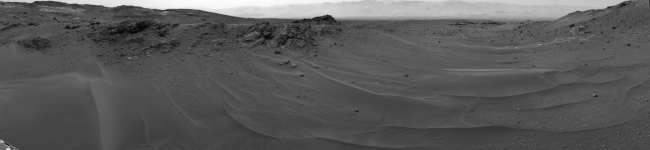 Ten Kilometers and Counting, on Mars,  NASA's Curiosity Mars rover used its Navigation Camera (Navcam) to capture this scene toward the west just after completing a drive that took the mission's ...