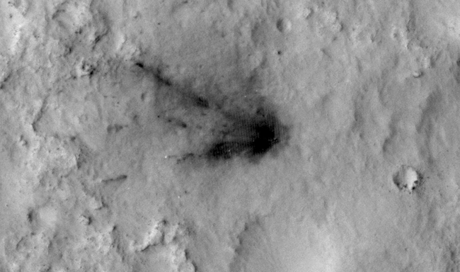 Changes in Scars From 2012 Mars Landing,  Main Animation  Figure 1  Figure 2  Figure 3  Spacecraft that land in dusty areas of Mars create dark blast zone patterns where bright dust is blown away by...