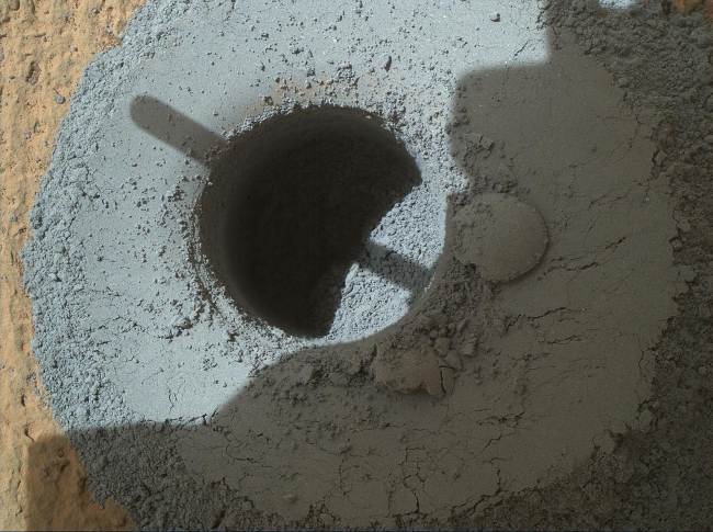 "Hole at 'Telegraph Peak' Drilled by Mars Rover Curiosity, This hole, with a diameter slightly smaller than a U.S. dime, was drilled by NASA's Curiosity Mars rover into a rock target called ""Telegraph Peak,"" within t..."