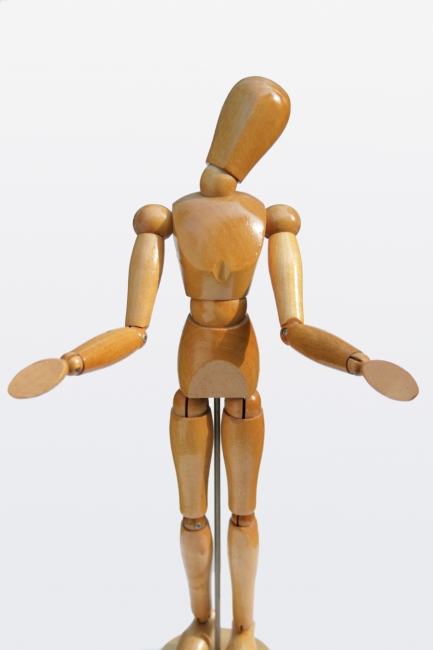 Mannequin feels pitty, Wooden painter's posing mannequin feels pitty, gesturing being-sorry or stumped with a tilted head and open arms, slight bukeh on the hands, light from upper...