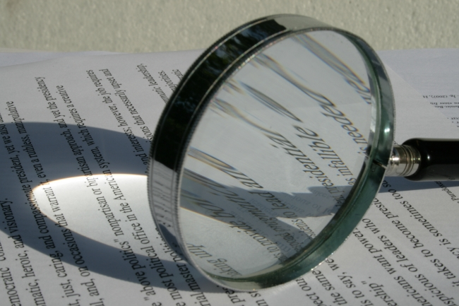 Magnifier on a piece of paper,