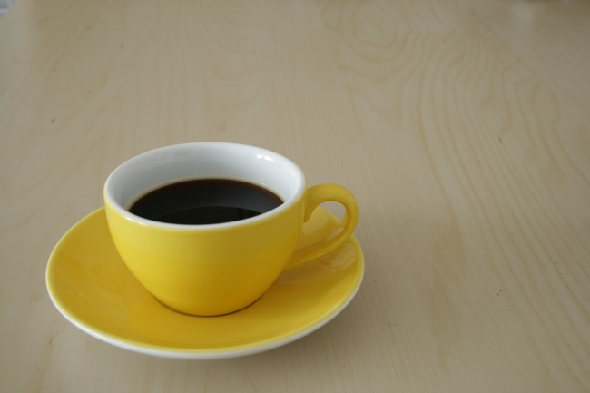 Cup of coffee on a conference table,