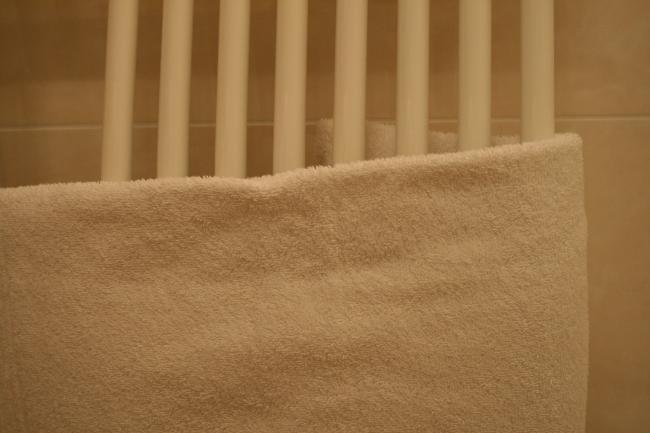 Hotel room bathroom 2, A towel over a radiator