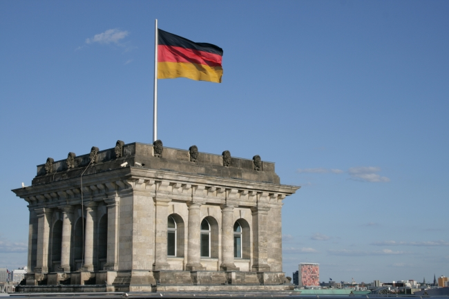 Corner tower of the Berlin Reichstag, with the German flag, photographed on the roof of the building
