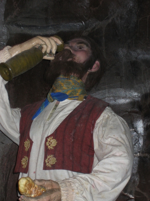 Trinkende Figur,