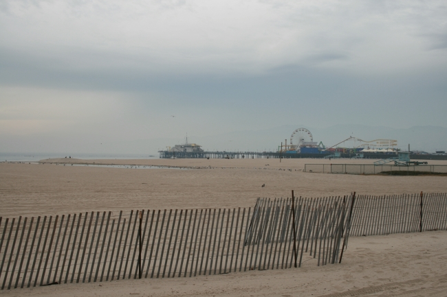 On Santa Monica beach, The ferris wheel of Santa Monica Pier in the distance