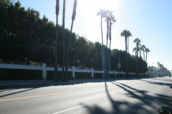 "Looking down Washington Blvd. with the Western fensce of the Sony Pictures Lot, with ""The Collonnade"" on the far right, the Thalberg Lot is behind the green"