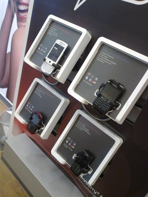 BlackBerrys and other mobiles on display,