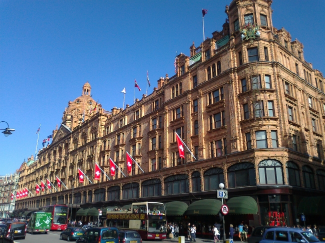 Harrods with Swiss flags drench in beautiful sunlight,