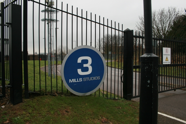 3 Mills Studio gate, and logo on the fence