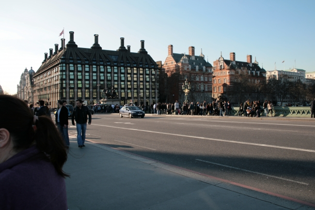 Portcullis House as seen from Westminster Bridge, Portcullis House is the building with the signature dark metal roof across the street from Big Ben
