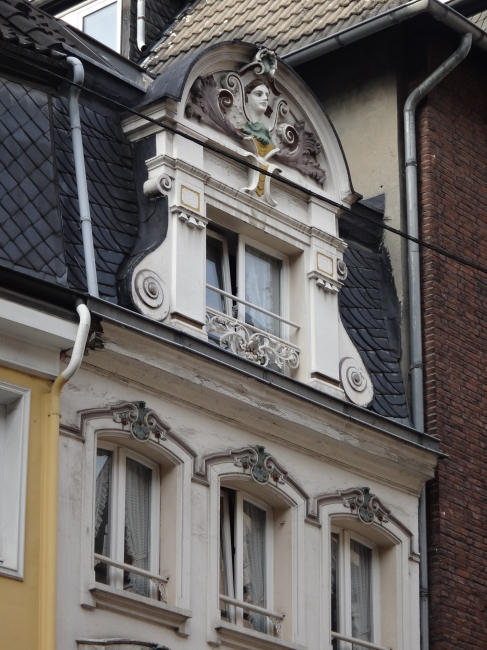 Picturesque window, detail of an old city house