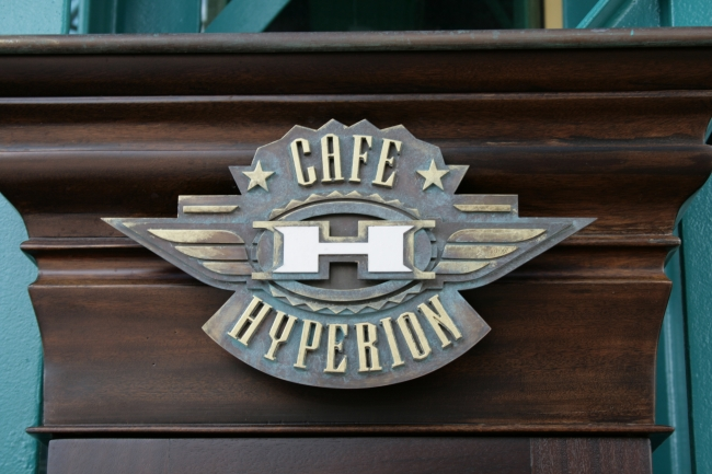 Café Hyperion logo sign, sharing space with Videopolis in Discoveryland