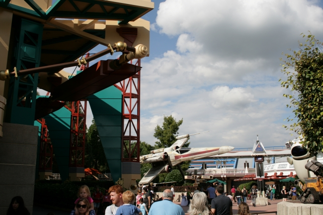 X-Wing fighter (and Videopolis structure), the X-Wing, now mainly associated with Jedi Academy, formerly advertising star Tours, which is seen in the background