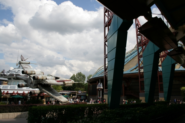 X-Wing, Star Tours and Discovery Mountain, seen through Videopolis stilts