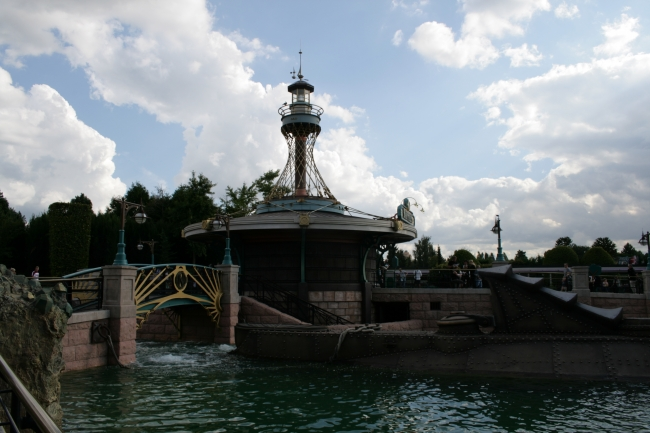 "Les Mystères du Nautilus, with actual Nautilus in front, while the ""lighthouse"" lantern of the entry staircase is more prominent"