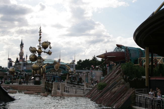 Overlooking the nautilus pond at Discoveryland, Orbitron, Hyperion airship, and a section of Space Mountain
