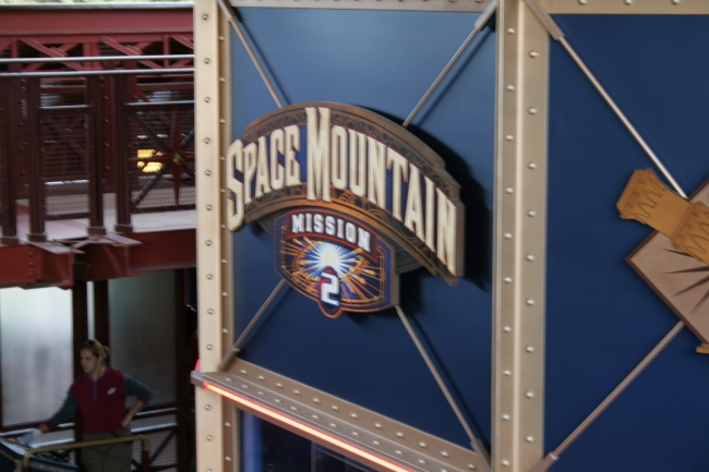 Space Mountain Mission 2 logo sign, tower over the control booth of the ride's boarding area