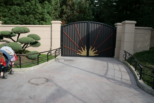 """Gate hiding """"the Disney Magic"""", this beautiful gate near Light Speed Photography shields a parade/service walkway behind Space Mountain - cast members only ;)"""