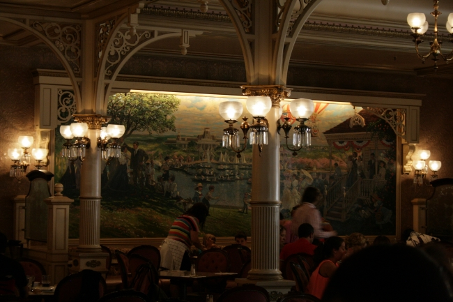 Inside Plaza Garden Restaurant, Wonderful fin-de-siecle wall mural artwork, note the lamps and chandeliers. Also, lamps cover the balloons on the wall mural here, expression of the ballon c...