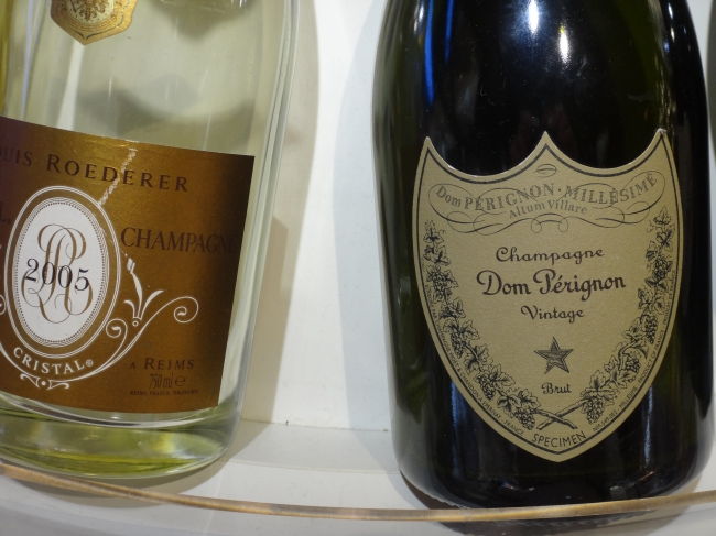 Champagner Dom Pérignon, Vintage, Brut, and to the left a bouteille of 2005 Roederer Champagner, at NCE Nice-Côte d'Azur airport