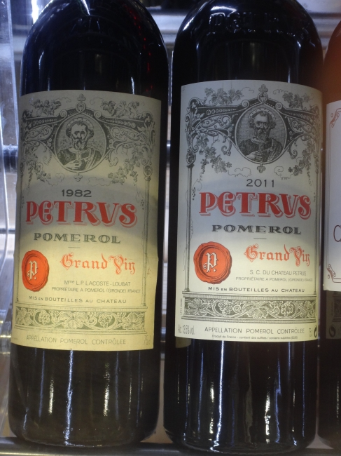 Chateau Petrus 1982 and Chateu Petrus 2011 Pomerol Grand Vin, two bottles of 75cl, the left 1982 one for 9600 EUROs, the bottle of 2011 Petrus for 3500 EUR, at duty-free NCE Nice-Côte d'Azur airport